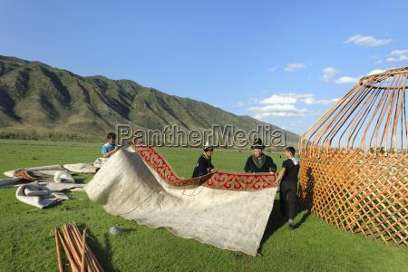 kazakh men putting up a yurt