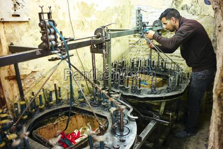 weaving silk in an artisan workshop