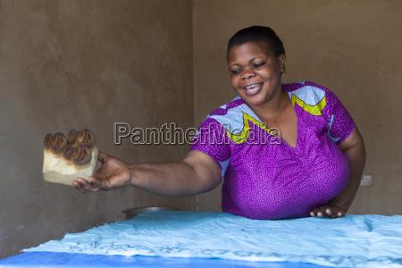 a woman making a new batik