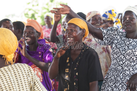 a group of women singing and