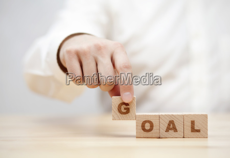 hand and word goal made with