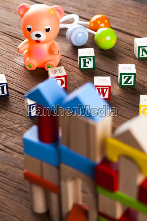 stuffed baby toys on wooden background