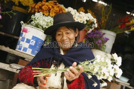 senior woman in flower shop lima